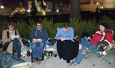 Some of my co-workers stand (or is it sit) vigil outside the Supreme Court building.